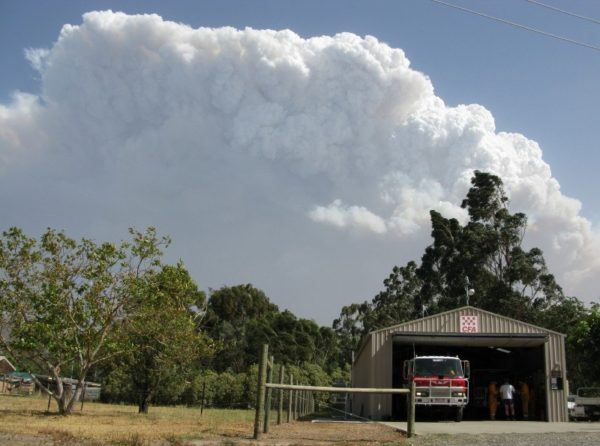 Taggerty Fire hall, with huge plume of smoke rising above. Victorian Bush Fire Diary - Day one