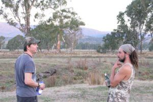 Two Aussie mates chatting in the bush