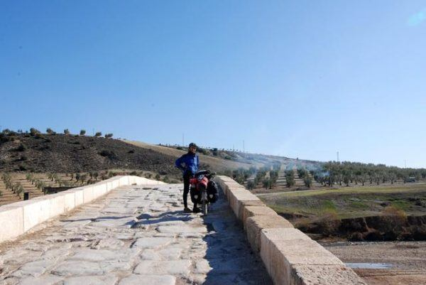 roman bridge in Turkey, with Friedel of Travelling Two and her bicycle
