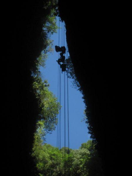 abseiling into a cave in Waitomo New Zealand