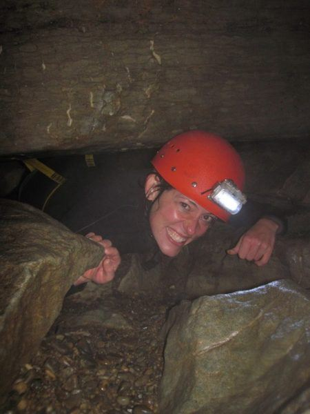 Nora Dunn, The Professional Hobo going through a tight squeeze inside a New Zealand cave
