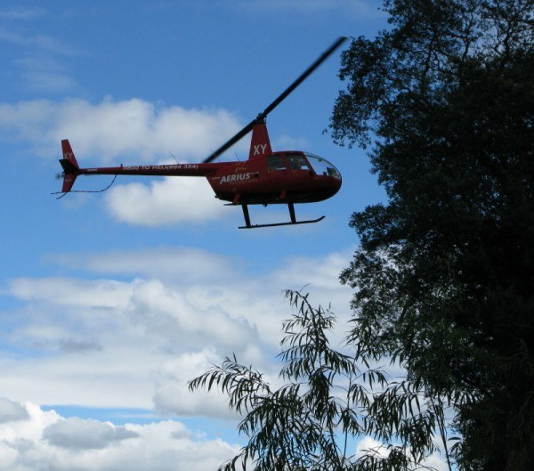 the Kaitiaki Adventures red helicopter which delivered us to our heli-sledging spot in New Zealand