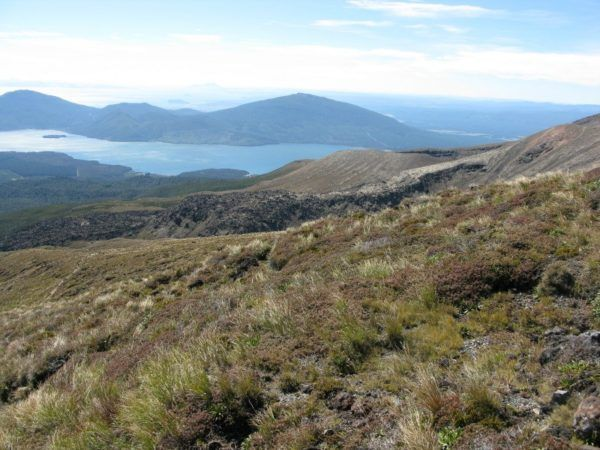 On the way down from the highest part of the Tongariro Alpine Trek, with a lake in the distance