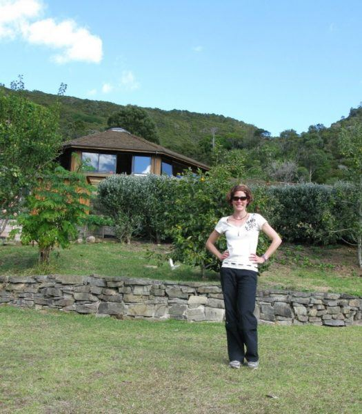 Nora Dunn standing in front of Mana Retreat Centre