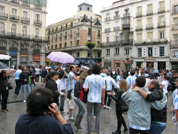 random celebrations and dancing in a square in Madrid