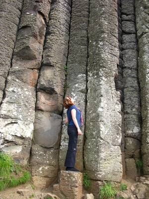 Looking up at the tall rocks at Giant's Causeway