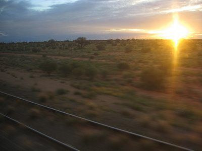 sunset over the outback as seen from The Ghan train
