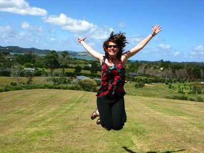 jumping for joy in New Zealand after four years of full-time travel