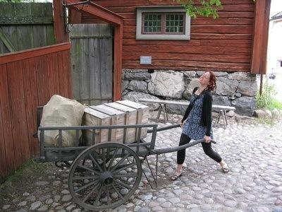 pretending to haul a heavy load at Skansen