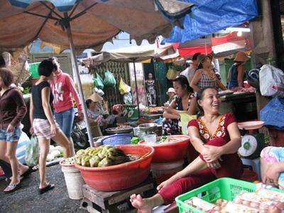 market stall owner in Vietnam street market