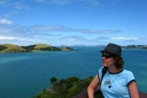 Nora Dunn, The Professional Hobo, overlooking the ocean in New Zealand