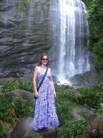 Nora Dunn, The Professional Hobo, in front of a beautiful Waterfall in Grenada