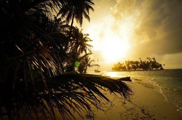 sun sets over island