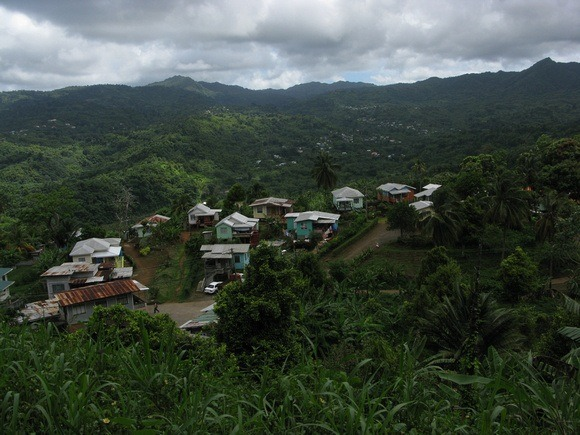 As we climb ever-higher, colourful little communities impossibly poke out of the dense rainforest