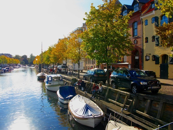 Copenhagen waterway with colourful trees and sunshine