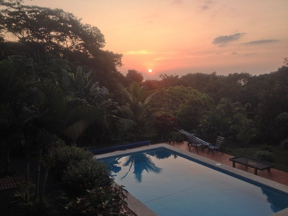 sunset over a pool in Panama in an expat neighbourhood