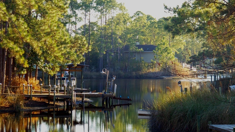 Santa Rosa lagoon with dock and colourful trees
