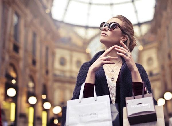 Mystery Shopper, woman wearing sunglasses with shopping bags
