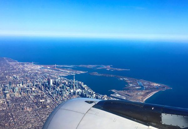 Flying over downtown Toronto, with Mystery Shopping Airfare