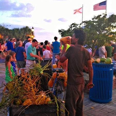 selling coconuts in Key West at the Sunset Celebration