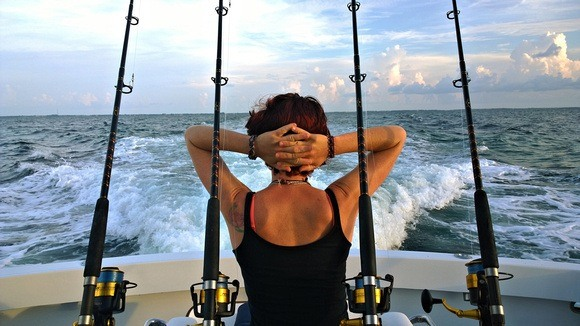 relaxing on a fishing boat with four fishing poles in the Florida Keys