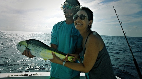 catching a fish while deep sea fishing