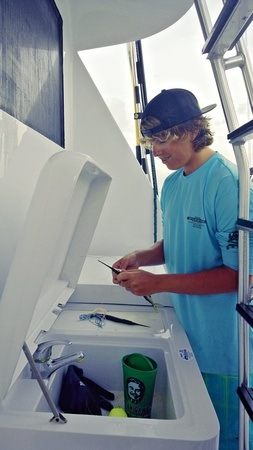 Mitch, a 15-year old first mate on a deep sea fishing charter in the Florida Keys