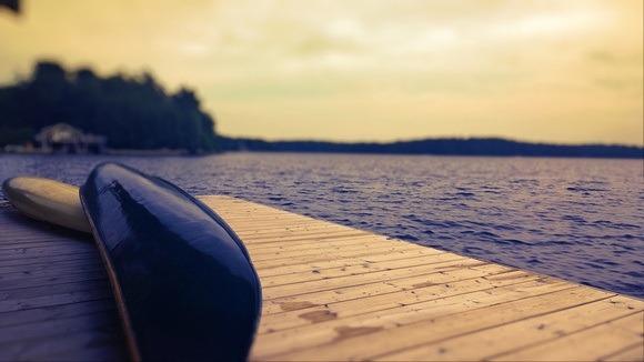 canoe on a dock on Lake Muskoka