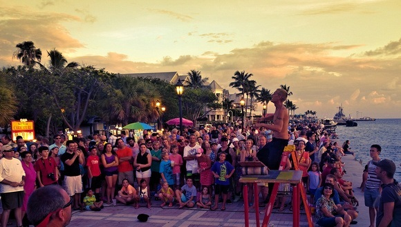 street performer performing to a crowd during sunset in Key West