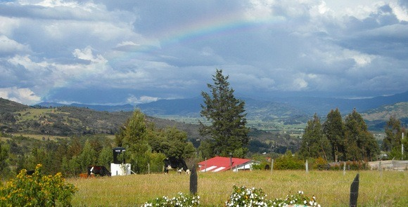 Colombia life can be magical! Here is a Colombia landscape outside Bogota with a rainbow