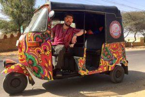 Will Hatton, The Broke Backpacker, in a rickshaw
