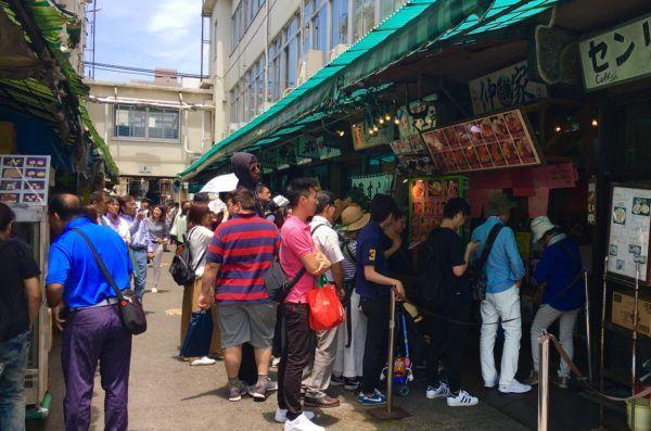 lining up at Tsukiji Fish Market outer market