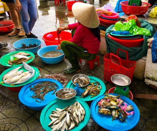 Hoi An street vendor selling fish