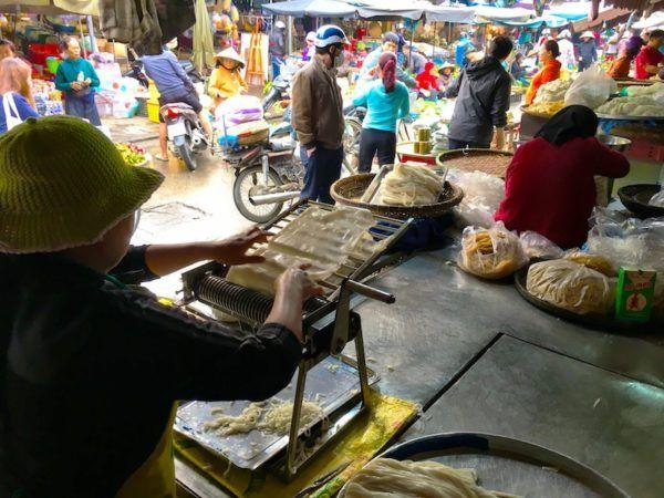 Hoi An market making fresh rice noodles
