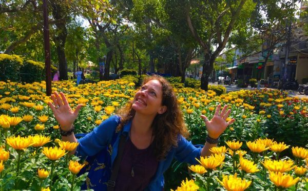 Nora Dunn, The Professional Hobo, enjoying the sunshine with Tet flowers in Hoi An