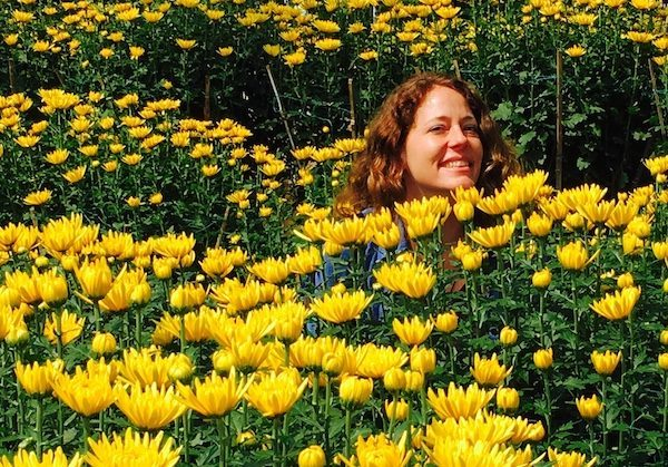 enjoying life in yellow flowers, while learning  various truths about travel