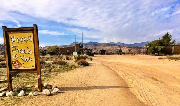 """""""Happy Trails to You"""" sign in the American desert, California, USA, 2018"""