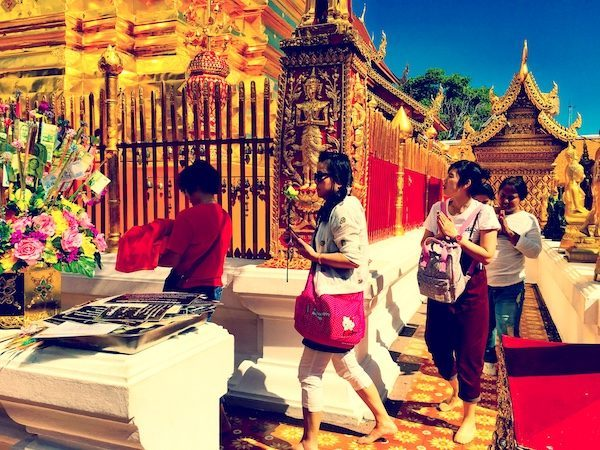 Praying at a Chiang Mai temple; the irony of expat living