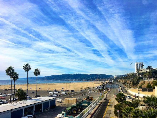 Los Angeles Santa Monica beach with big sky; a home base in LA will cost you! Tricky for financially sustainable travel. Tips on creating a long term travel budget.