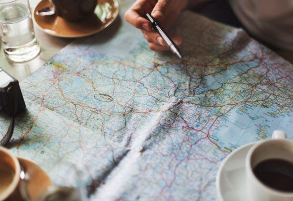 travel planning with a map - create your travel expenses budget before you go