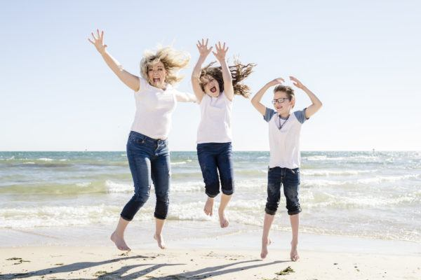 Erin Holmes and family on the beach, loving the travel lifestyle!
