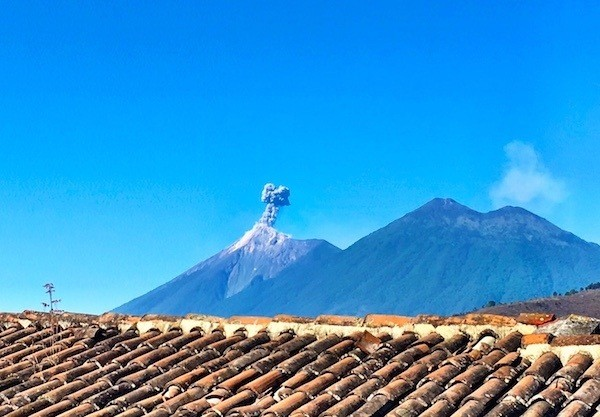 The view of Antigua's volcano Fuego, from the rooftop of Posada San Sebastian