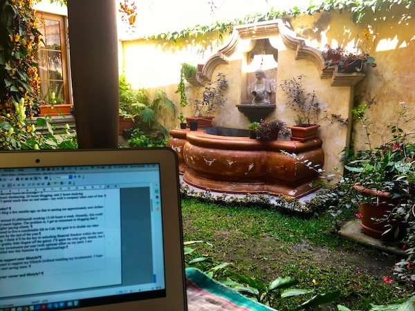 Working on a laptop in the garden of Canela - a great bakery and restaurant in Antigua Guatemala