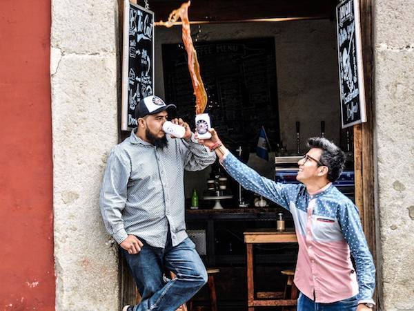 Tossing coffee at Fat Cat Coffee House - one of the best places to have coffee in Antigua Guatemala