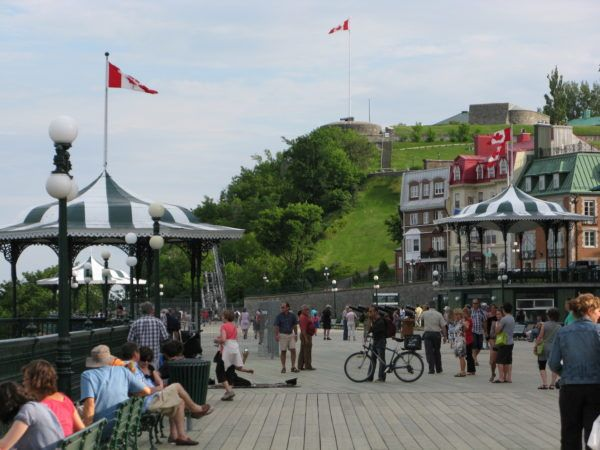 Mystery Shoppers with Shopping Bags in Quebec Chateau Frontenac boardwalk