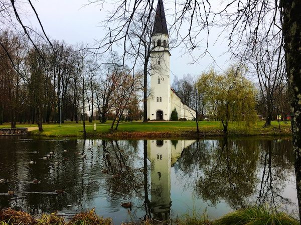 Charming Sigulda Latvia, church reflected in a pond - Things to do in Latvia