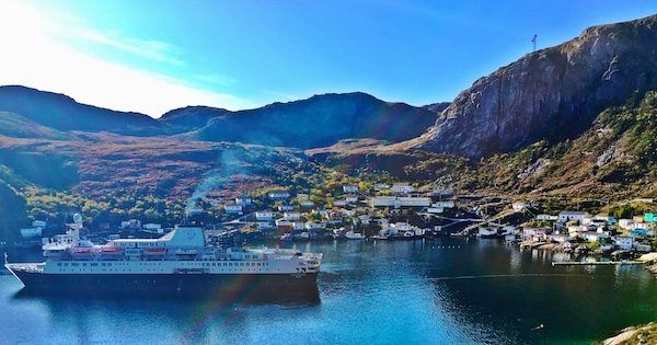 The town of Francois in Newfoundland, with Adventure Canada cruise boat in the foreground