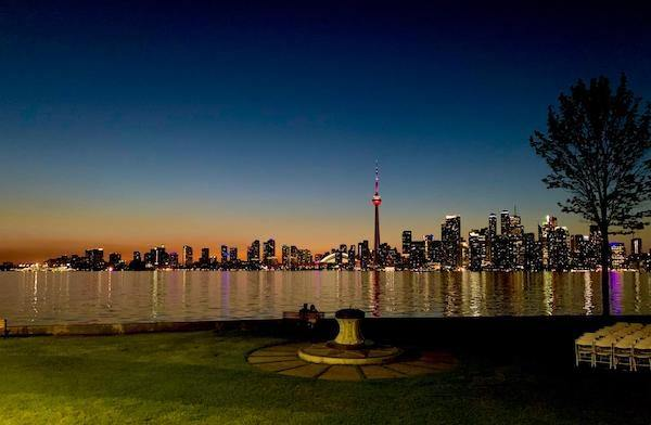Toronto downtown lit up at sunset, with Lake Ontario in front