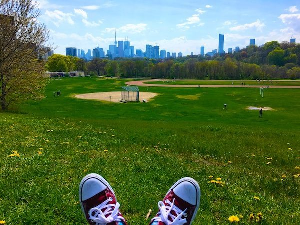 summer in Toronto, overlooking green baseball field with downtown city buildings in the background