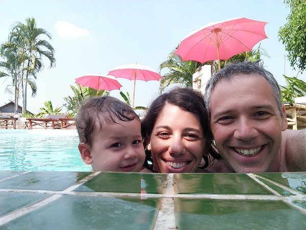 Shlomo Freund (of Free Financial Self) and his wife and daughter in a pool